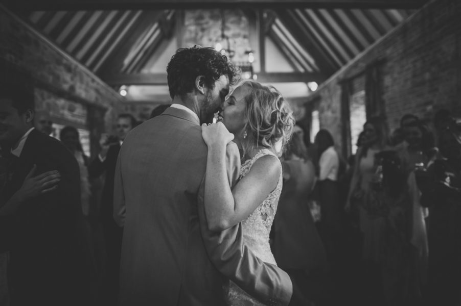 bride and groom kissing at their first dance at rockley manor