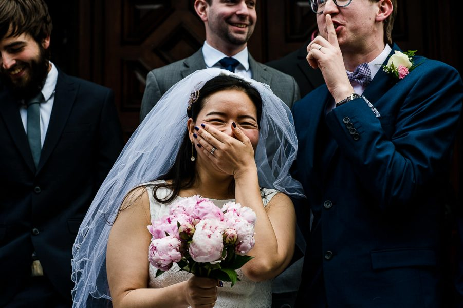bride and groom laughing at their sussex wedding