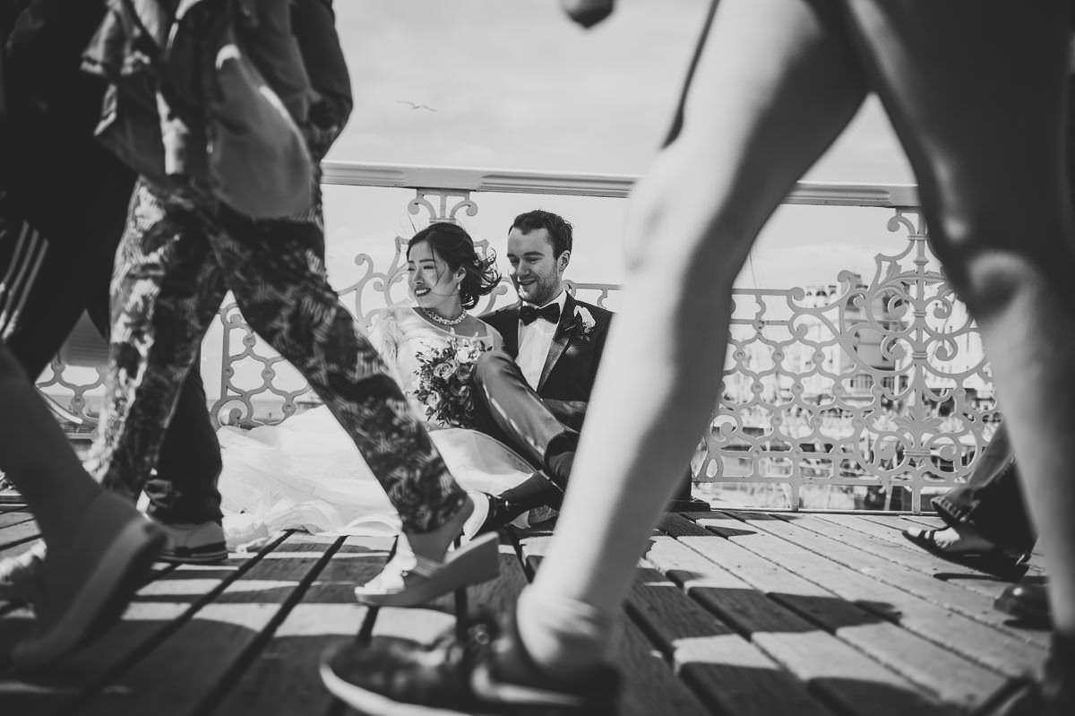 bride and groom on brighton pier