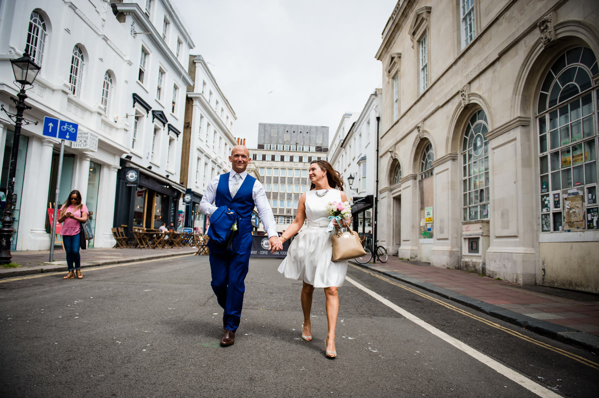bride and groom walking to the town hall in brighton
