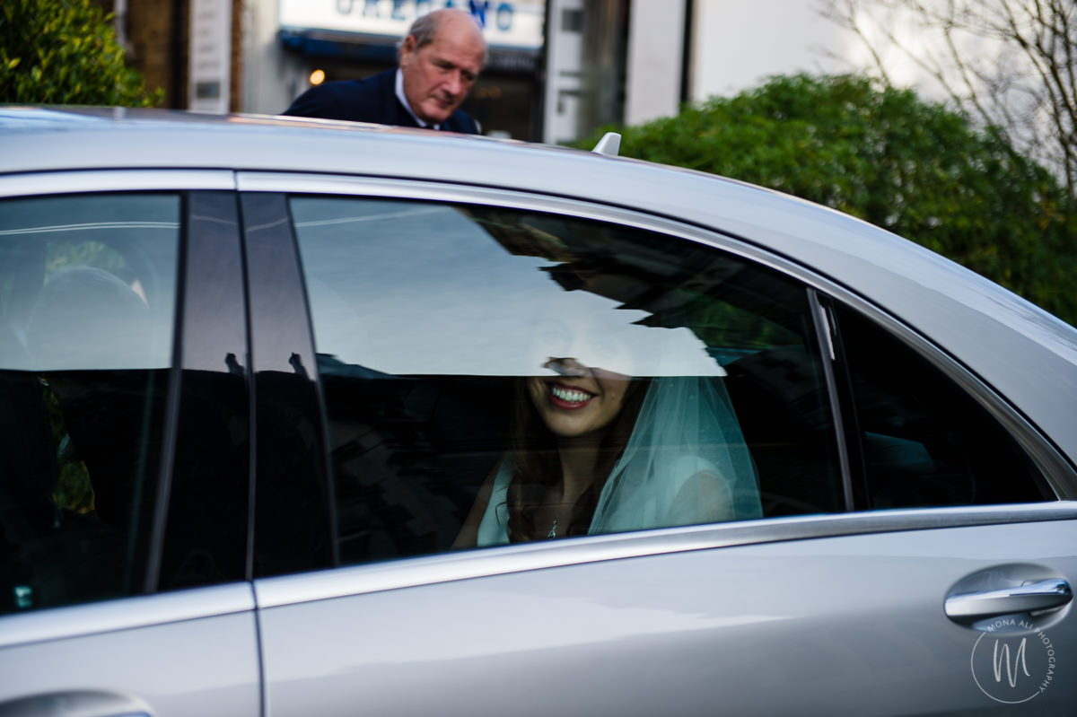 smiling bride arrives at church for her wedding